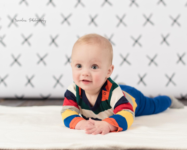 6 month boy laying floor happy_Brandau Photography.jpg