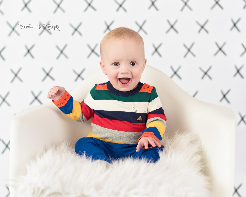 6 month boy smiling chair_Brandau Photography.jpg