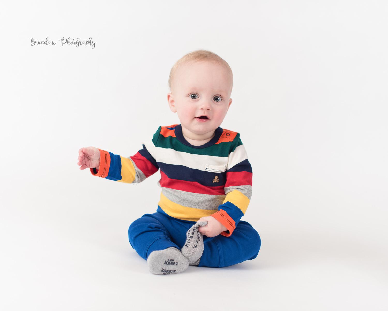 6 month boy taking off sock _Brandau Photography.jpg