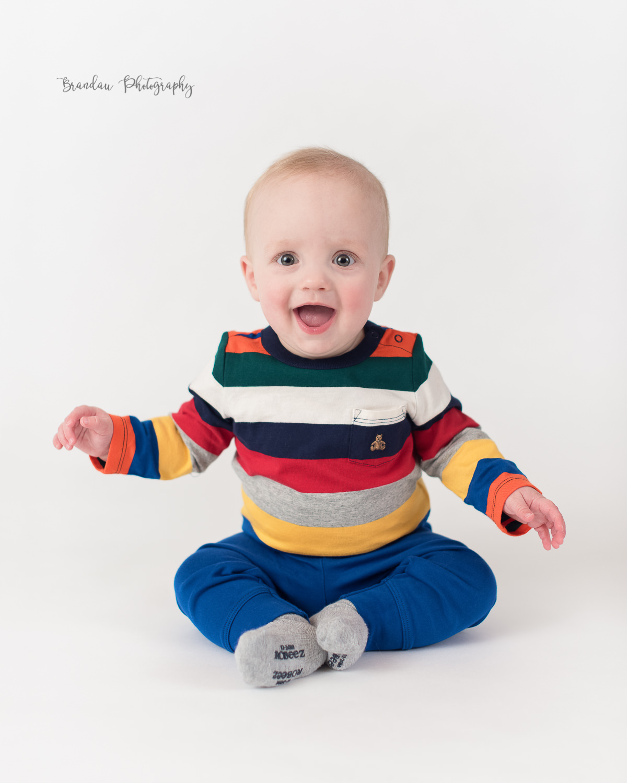 baby boy laughing white background _Brandau Photography.jpg