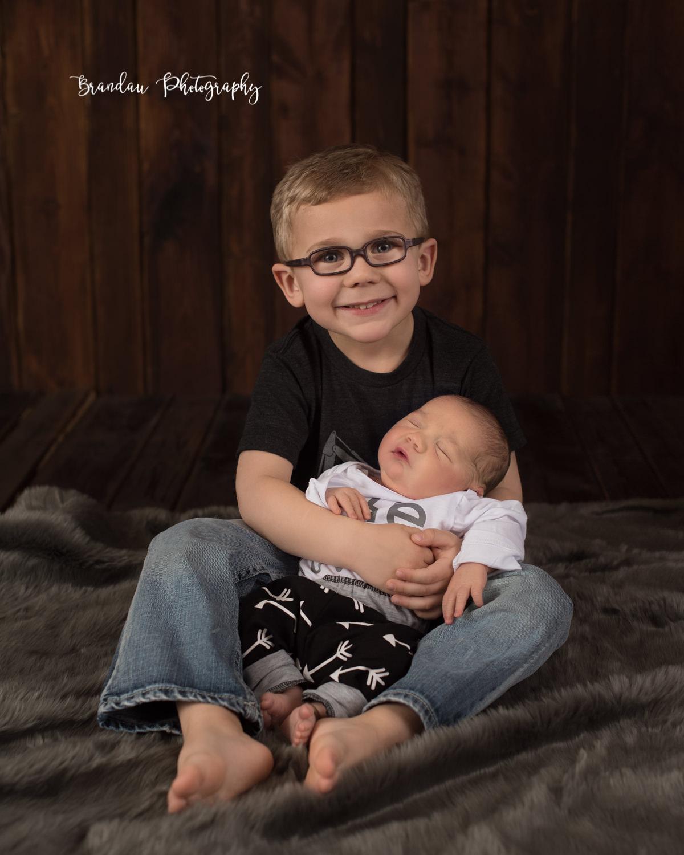 boy holding baby_Brandau Photography.jpg