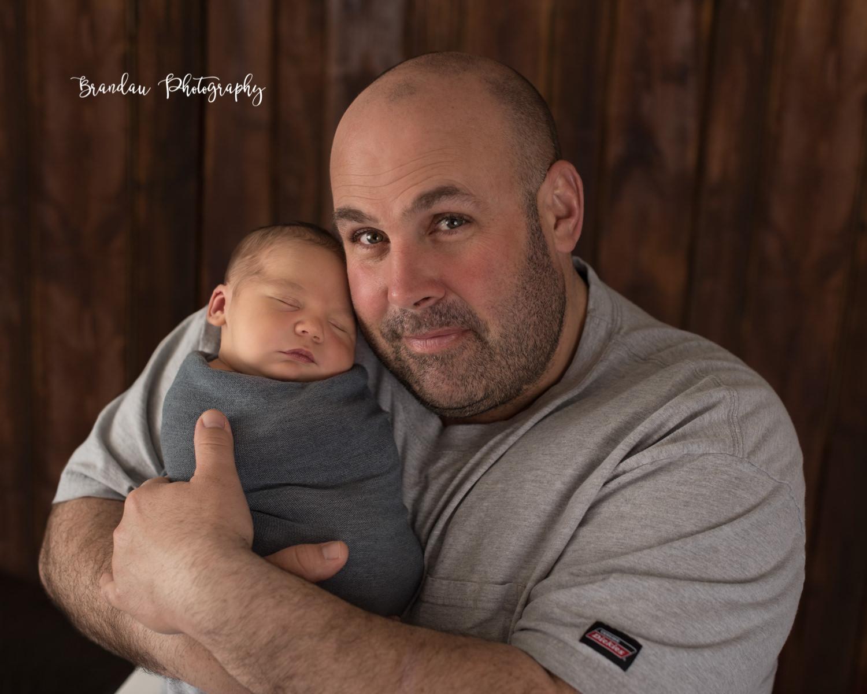 Dad holding baby_Brandau Photography.jpg