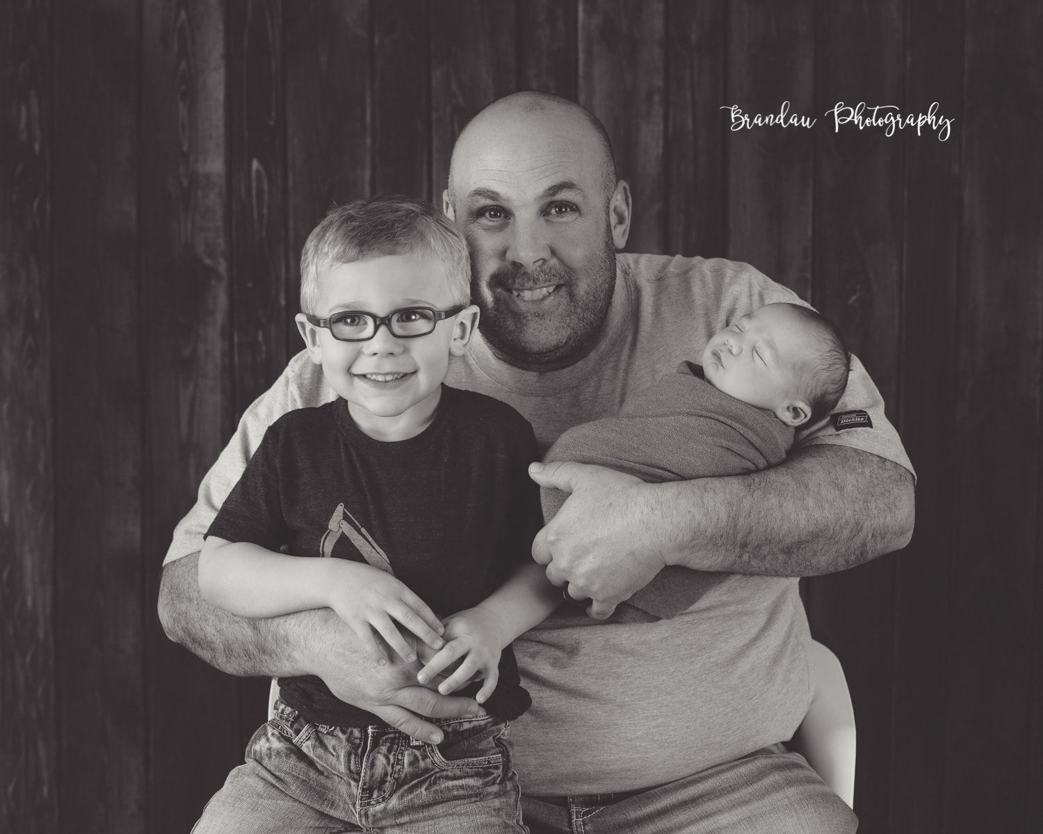 Dad holding brothers_Brandau Photography.jpg