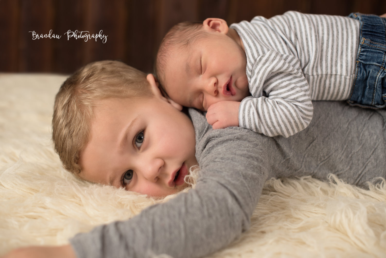 newborn laying on brother_Brandau Photography.jpg