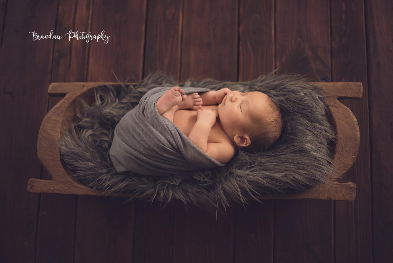 newborn sleeping in bread bowl_Brandau Photography.jpg