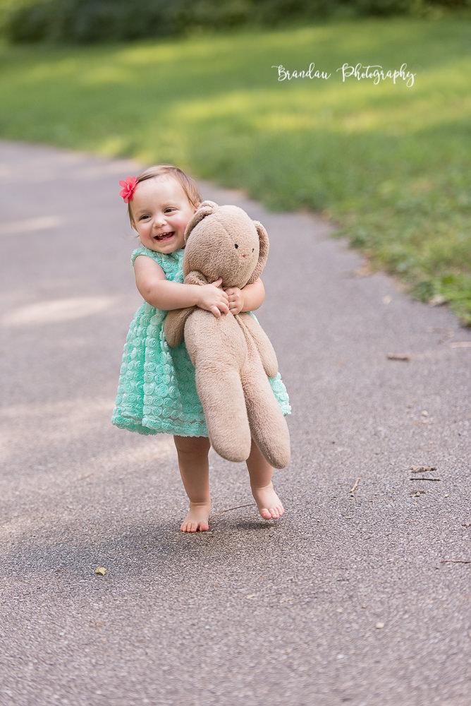 Brandau Photography - Girl smiling with bear.jpg