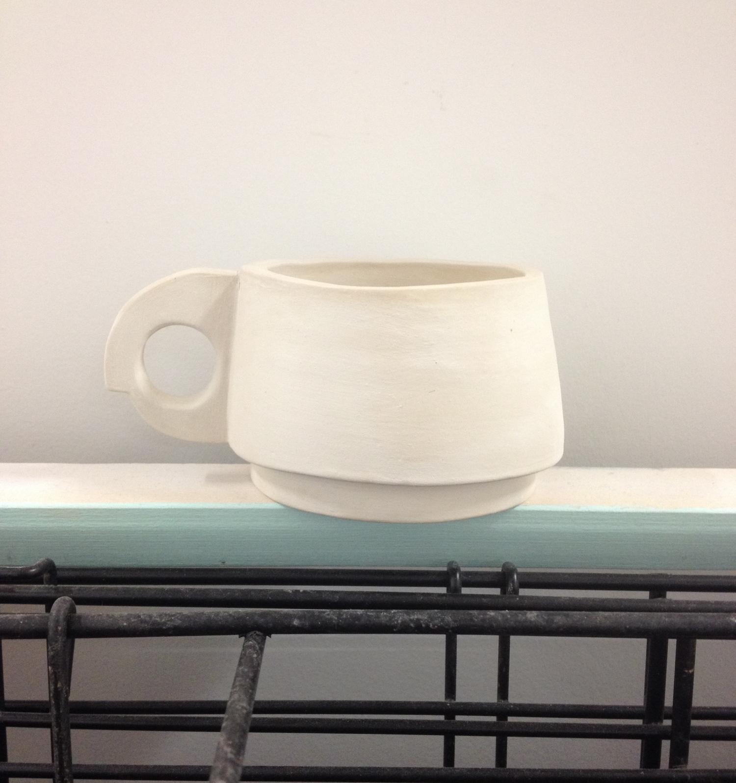 Un fired (green) porcelain and terracotta mugs
