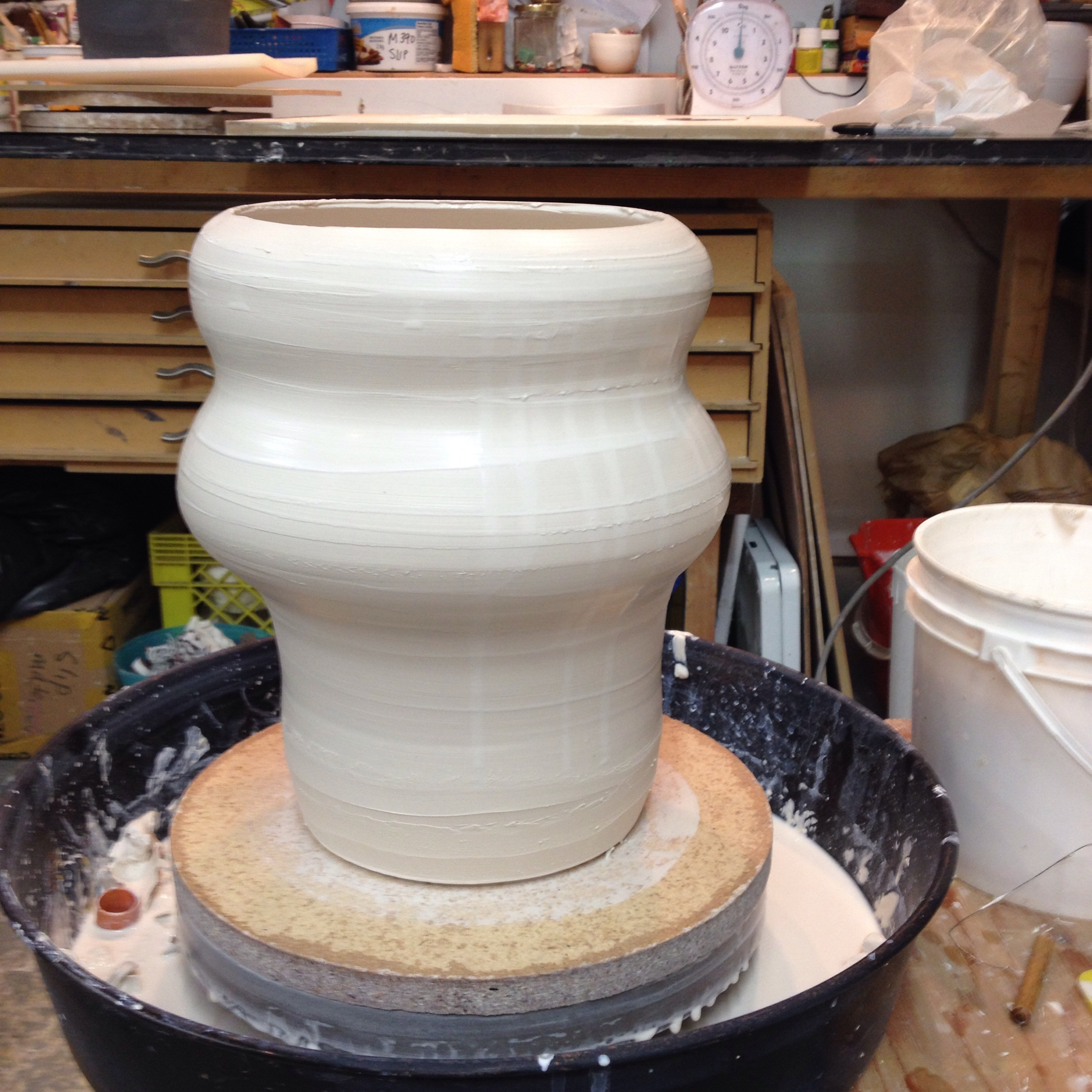 "This is one of the medium sized shades. 14 lbs of porcelain, approximately 11"" tall."