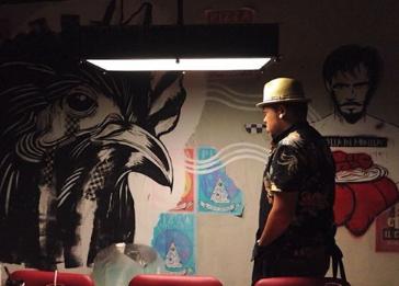 Artist Dee Jae Paeste staring down the bird.