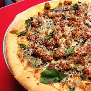 Local longganiza, scamorza (a smoked Italian mozzarella), chili leaves and garlic oil pizza.