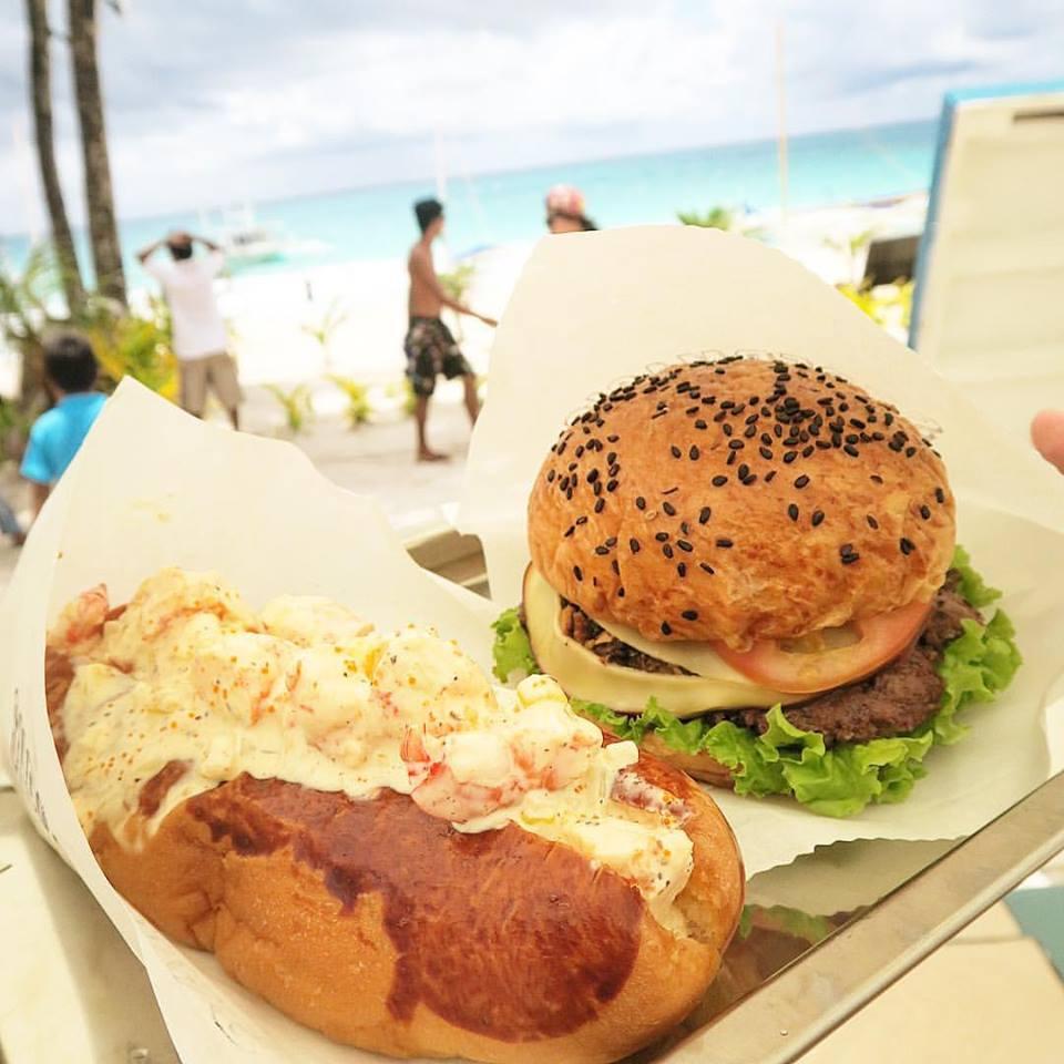 Shrimp rolls and umami bomb burgers at   #SupermagicBurgers    🍔  -- fun grub at the   #NowieFeast2015    #BoracayFoodTour