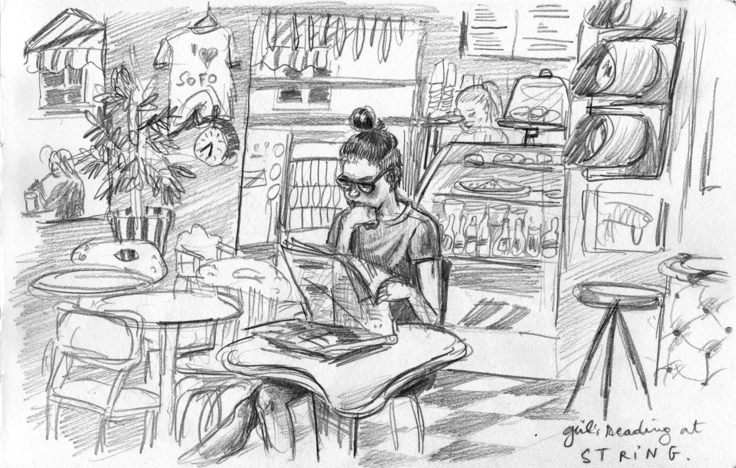 Girl reading at String café.jpg