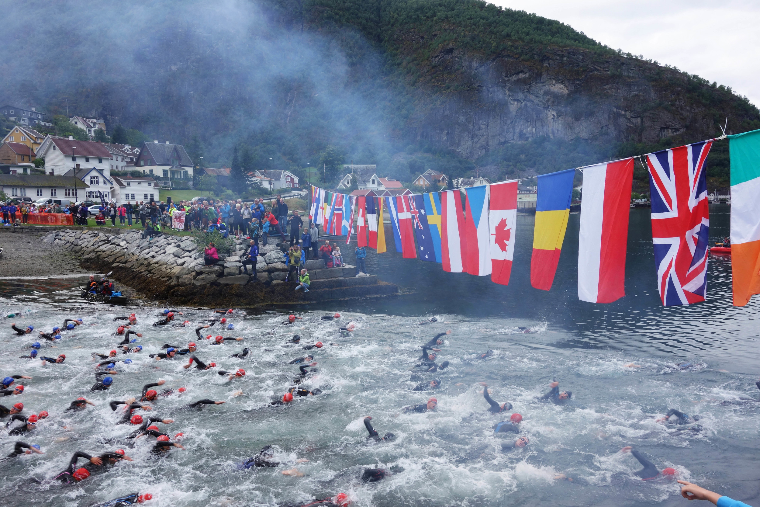 Seconds after the start of the Aurland Xtreme Triathlon 2014 where swimmers exit the bay for their 1.900 meters in the fjords. You can find me just right where the finger points at the bottom right.