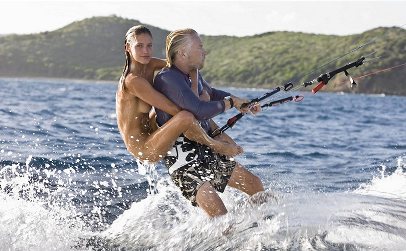 To train our core most of us use free weights while others prefer to kitesurf with naked supermodels on their back. Legend Sir Richard Branson kitesurfing with a naked supermodel on his back.