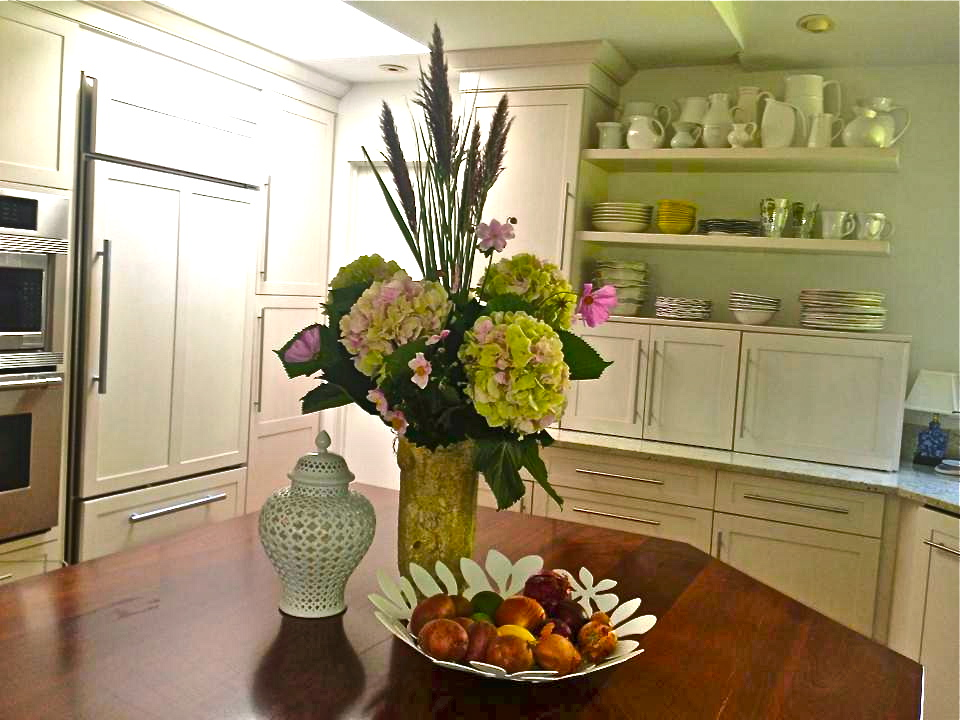 Gorgeous Hydrangea flower arrangement adds a pop of color to this spacious New York City apartment.