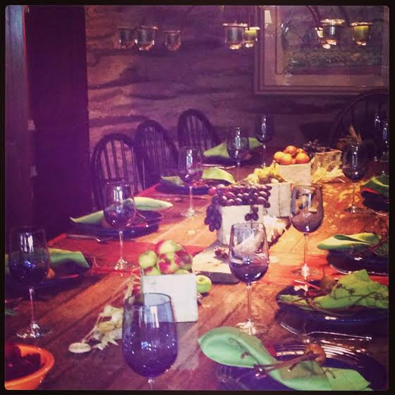 Harvest season table with edible decor and grapevine napkin rings.