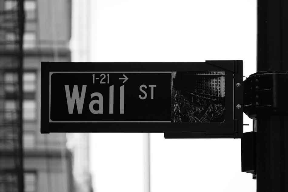 Black and white photo of a Wall Street road sign