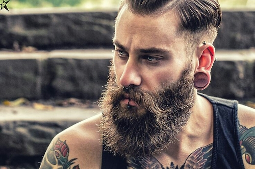 This man has decided to trim his beard into waves and continue to grow a lengthy mustache. It just looks odd!