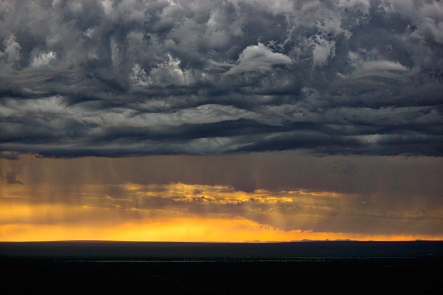 Late afternoon rain over Mabalingwe    © Photography by Marthinus Duckitt