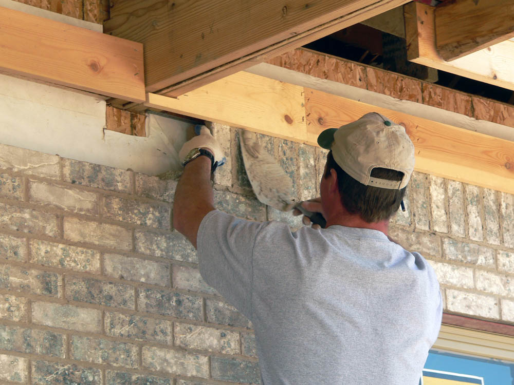 Construction contractor remodeling wall
