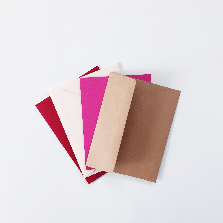envelope color choices: red, blush pink, hot pink, kraft