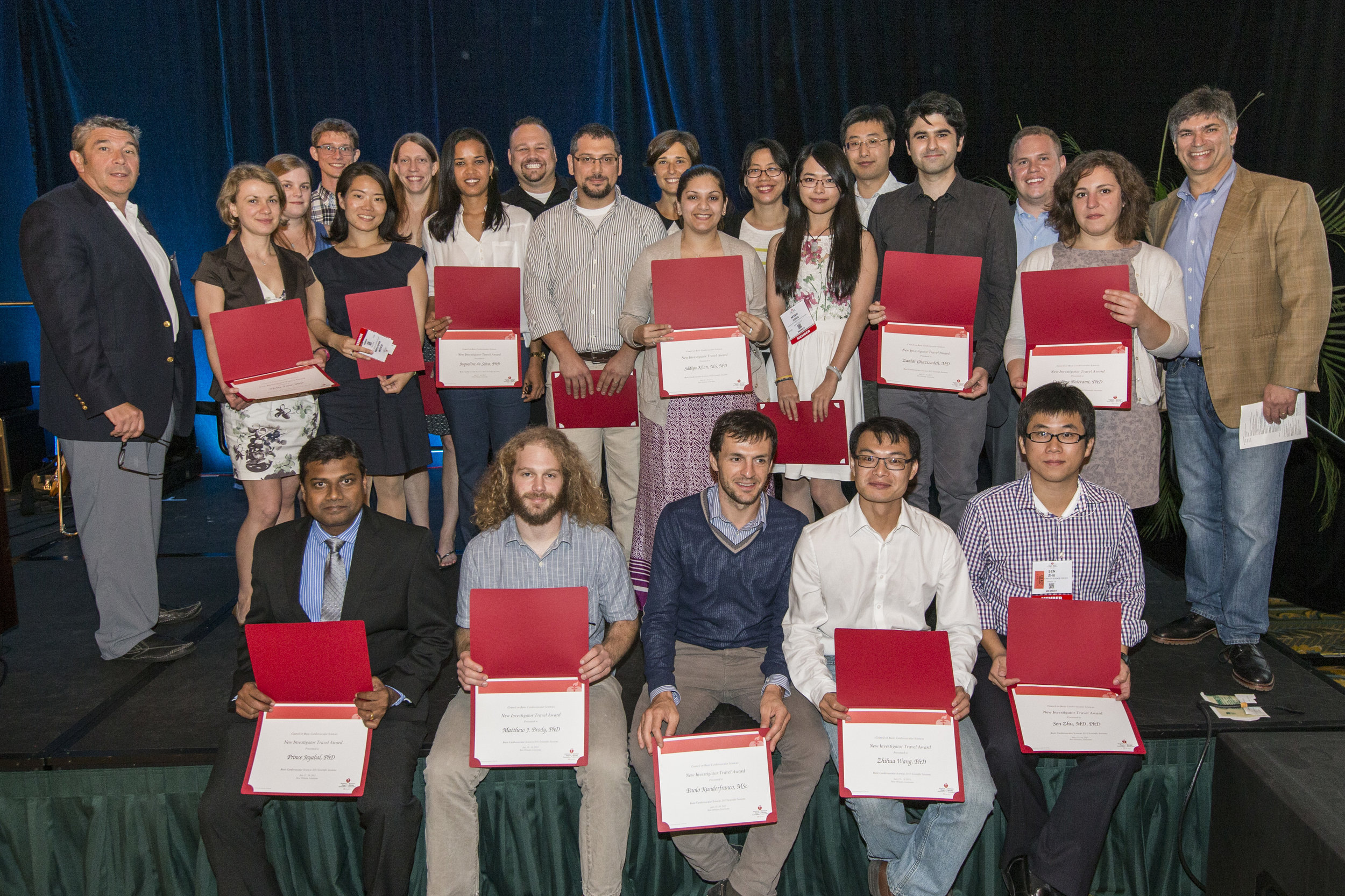 Tim Luongo (3rd from right, top row) after receiving his award.