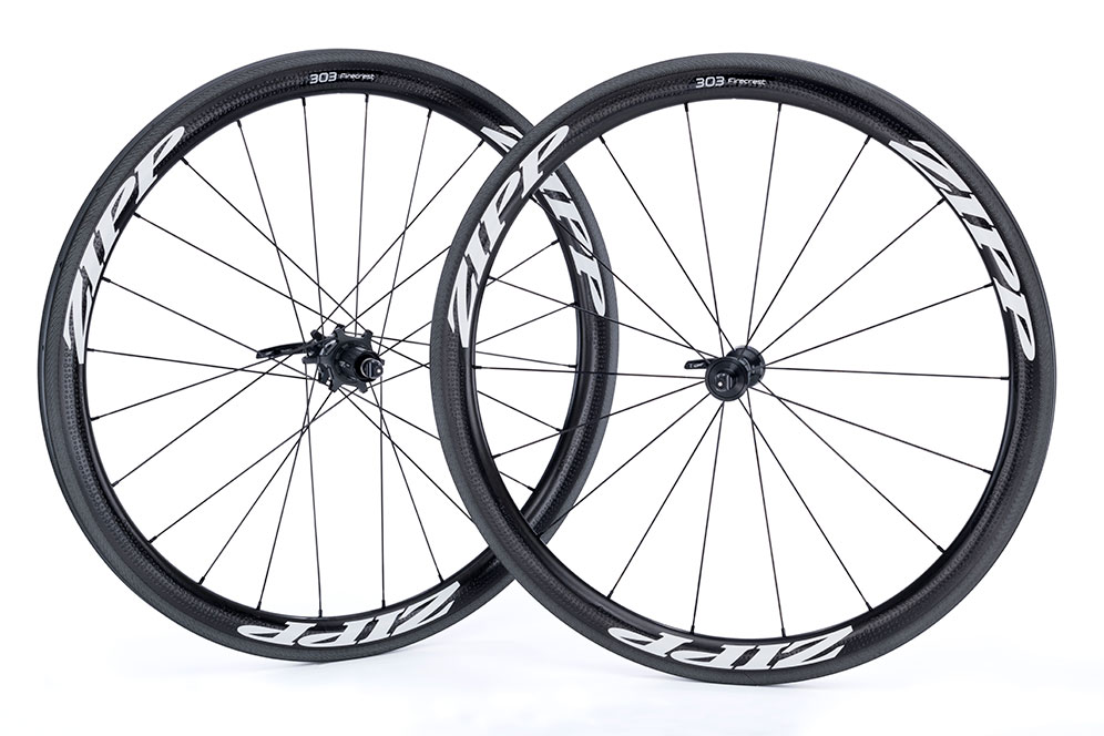 303 Firecrest® Clincher    If perfection is the standard, then the 303 Firecrest wheelset delivers everything you could ask for, including a heritage forged – and still thriving – in the world's toughest races. At the center of the 303 Firecrest Tubular is the 77/177 hubset, an innovation that results in improved stiffness, durability, simplicity and versatility.  Zipp's original 303 made history by becoming the first carbon wheelset to win cycling's two most famous Cobbled Classics, Paris-Roubaix and the Tour of Flanders. The 303's wider rim provided extra durability, and improved aerodynamics. That wider rim also led to the development of our revolutionary Firecrest® platform platform that further reduces aerodynamic drag while increasing crosswind stability. The 303 Firecrest is a go-to wheelset for the pros of Boels-Dolmans, AG2R LA MONDIALE, Axeon Cycling and others.
