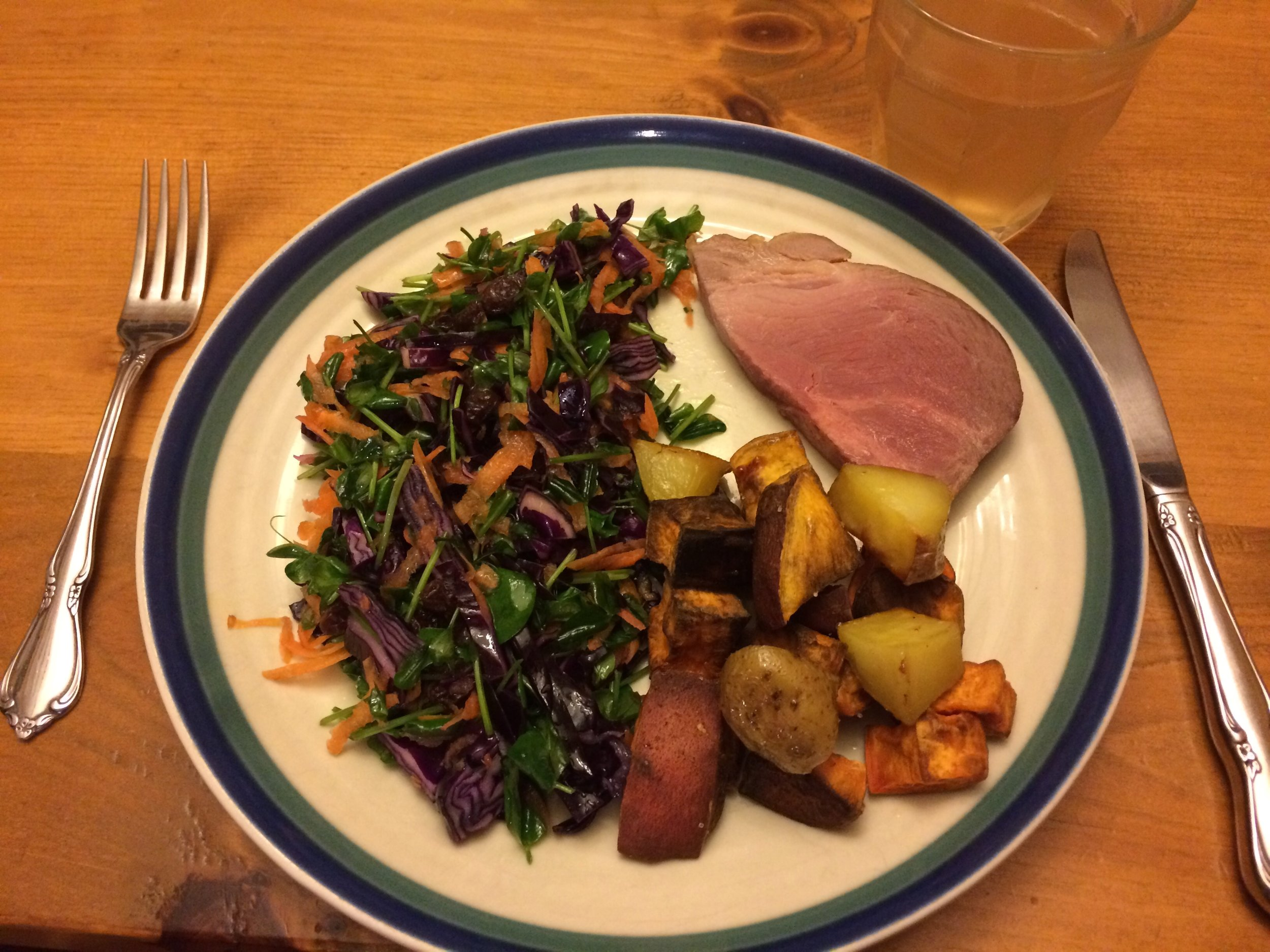 Here's an example of an AIP or Paleo meal. 1/2 plate filled with Red Cabbage-Carrot-Pea Shoot salad with olive oil, 1/4 plate with a piece of pasture-raised, traditionally cured ham, and a 1/4 plate with a mix of sweet potato and yams roasted in bacon fat.