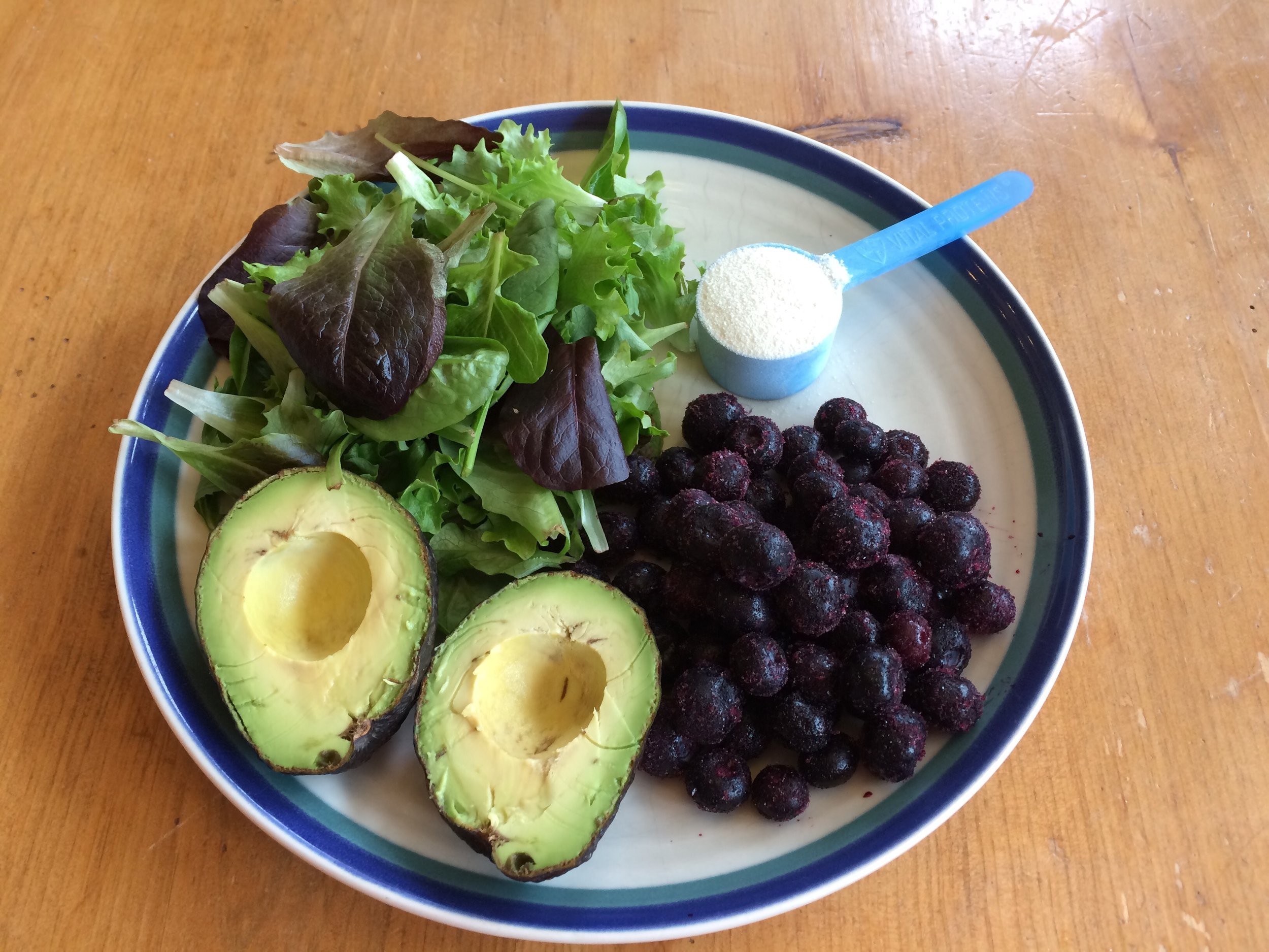 Here's an example of ingredients for a Blueberry Avocado Smoothie that fit my Gut-Healthy criteria for the new Canada's Food Guide. 1/2 the plate is filled with leafy greens and avocado (technically a fruit, but since it's low carb, I include it in my Vegetable section), 1/4 plate with blueberries, and I've added a scoop of collagen powder for my protein. The avocado also provides the healthy fat, and makes this smoothie rich and creamy. I just blend the vegetables and fruit up with water, and then add the collagen at the end.