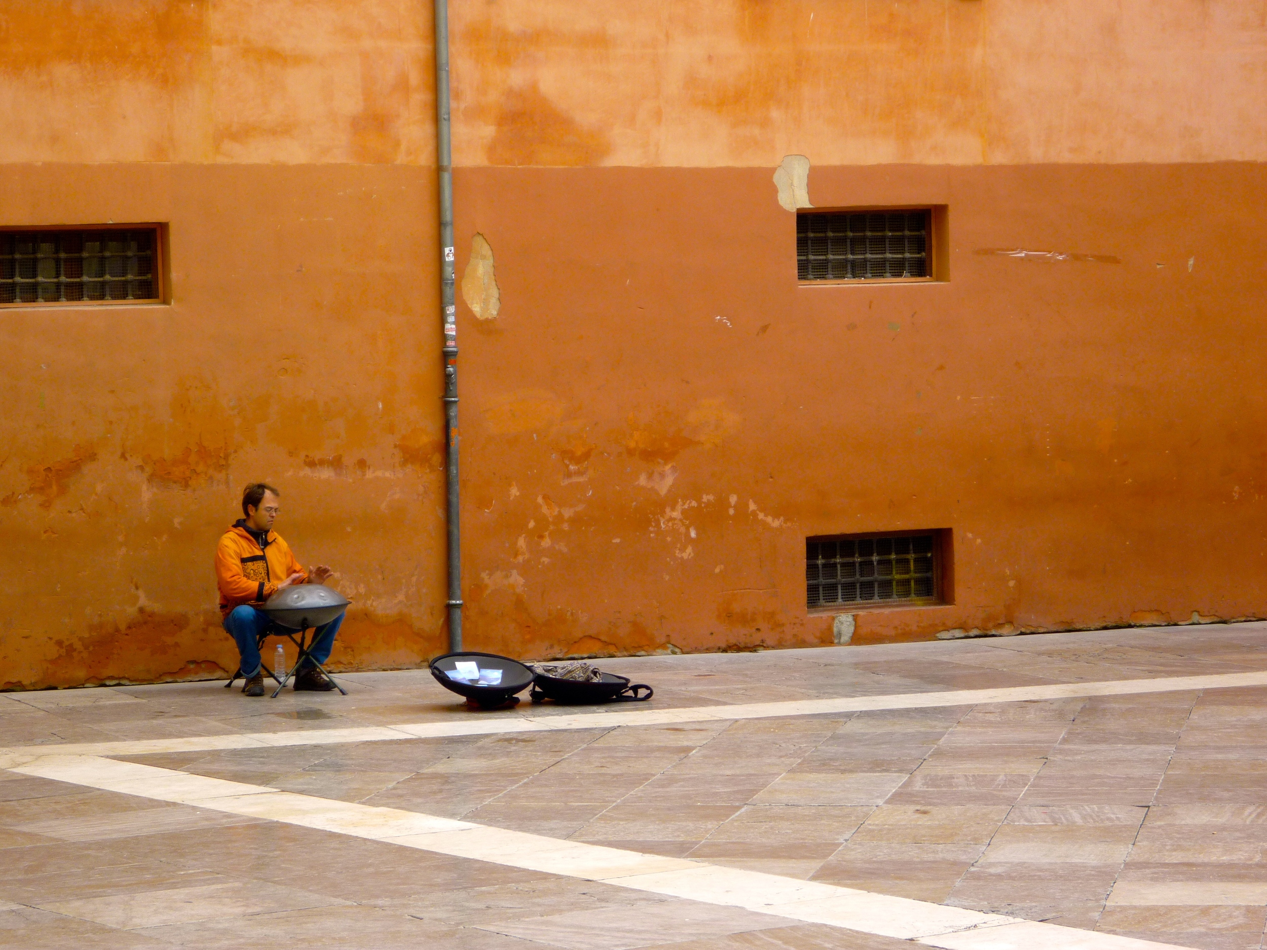 A street musician playing the hang/handpan
