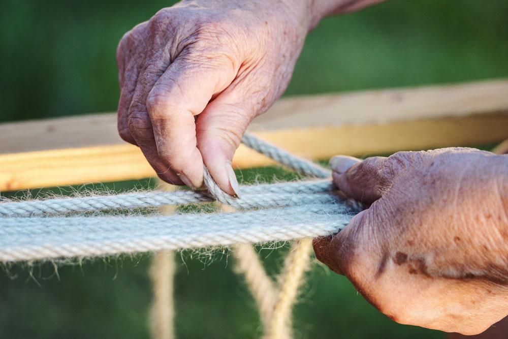 Huston hands weaving one