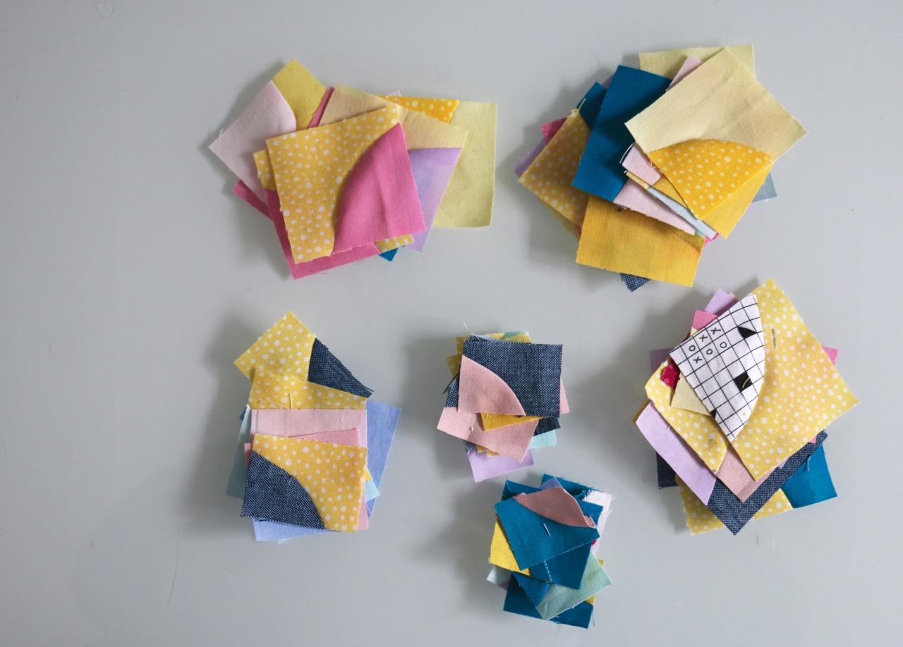 Tiny improv Drunkards Path quilt blocks