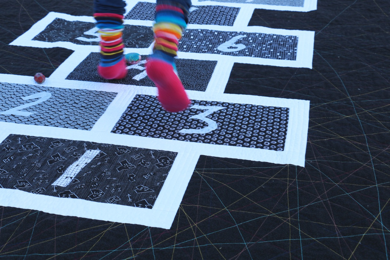 Hopscotch quilt with Tag Fabrics