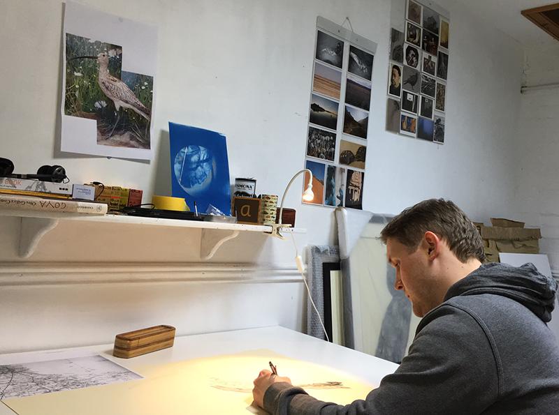 Chris Otley working in his artist studio