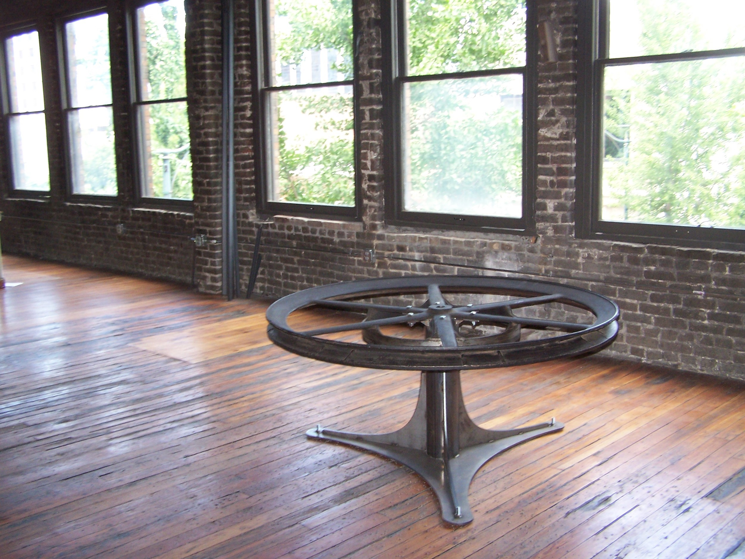 Table made out of elevator pulley wheel