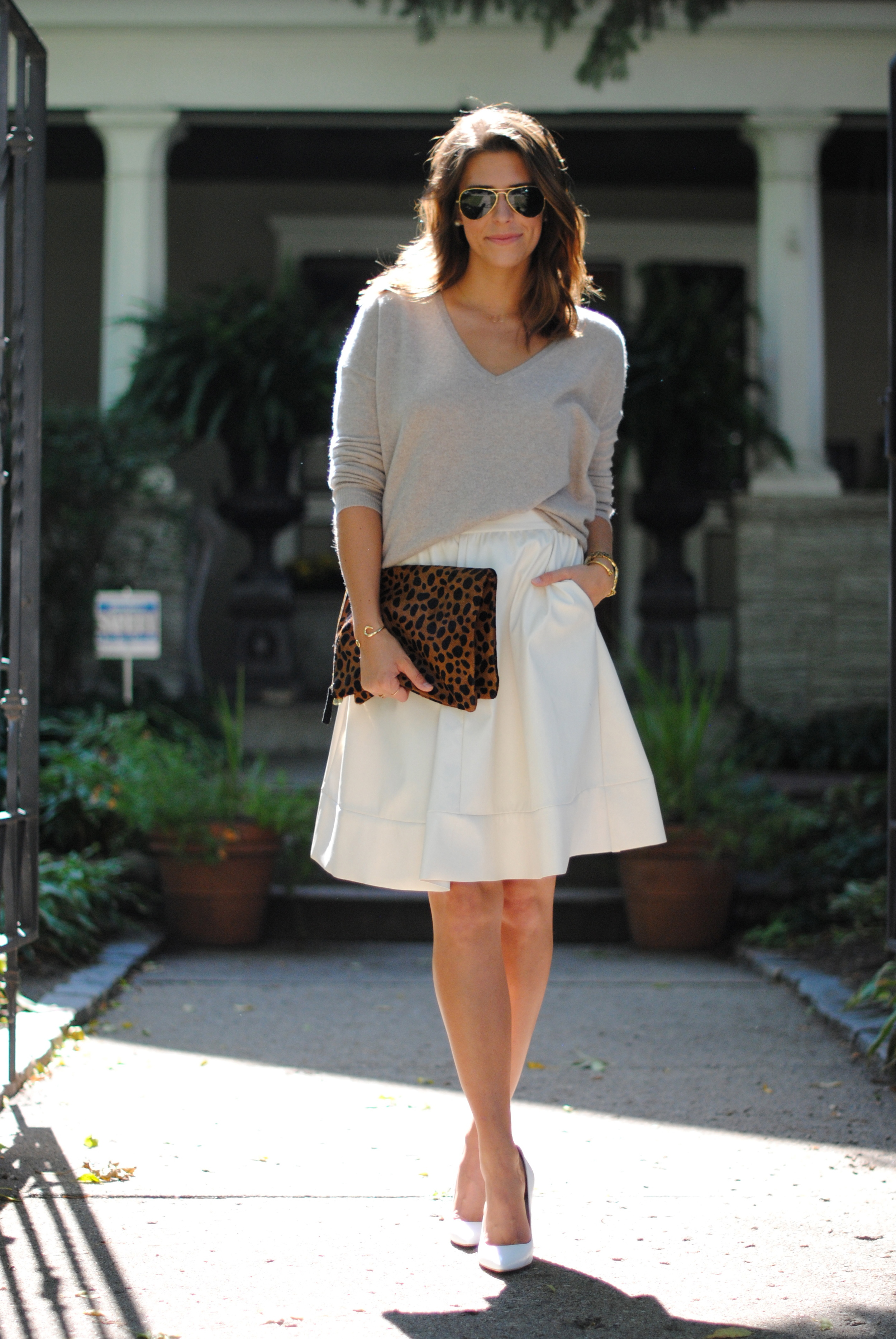 Barrow & Grove cashmere sweater  alternative  here   White faux leather skirt (sold out) alternative  here    Topshop white pumps    Clare Vivier oversized leopard clutch    Ray-Ban Aviators