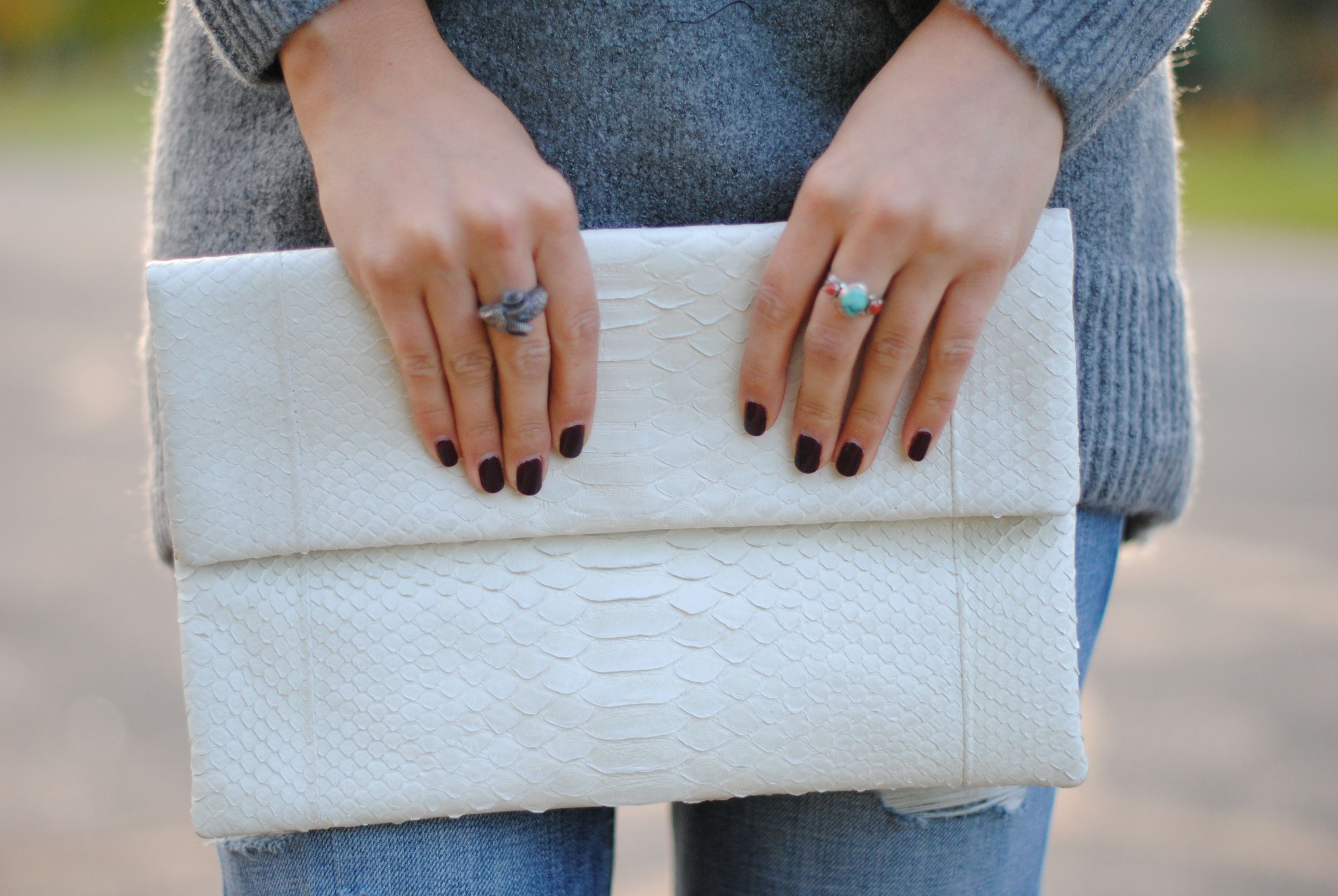 Snakeskin clutch   Silver rings from Greece and Sicily  Nail color:  OPI Can You Tapas This