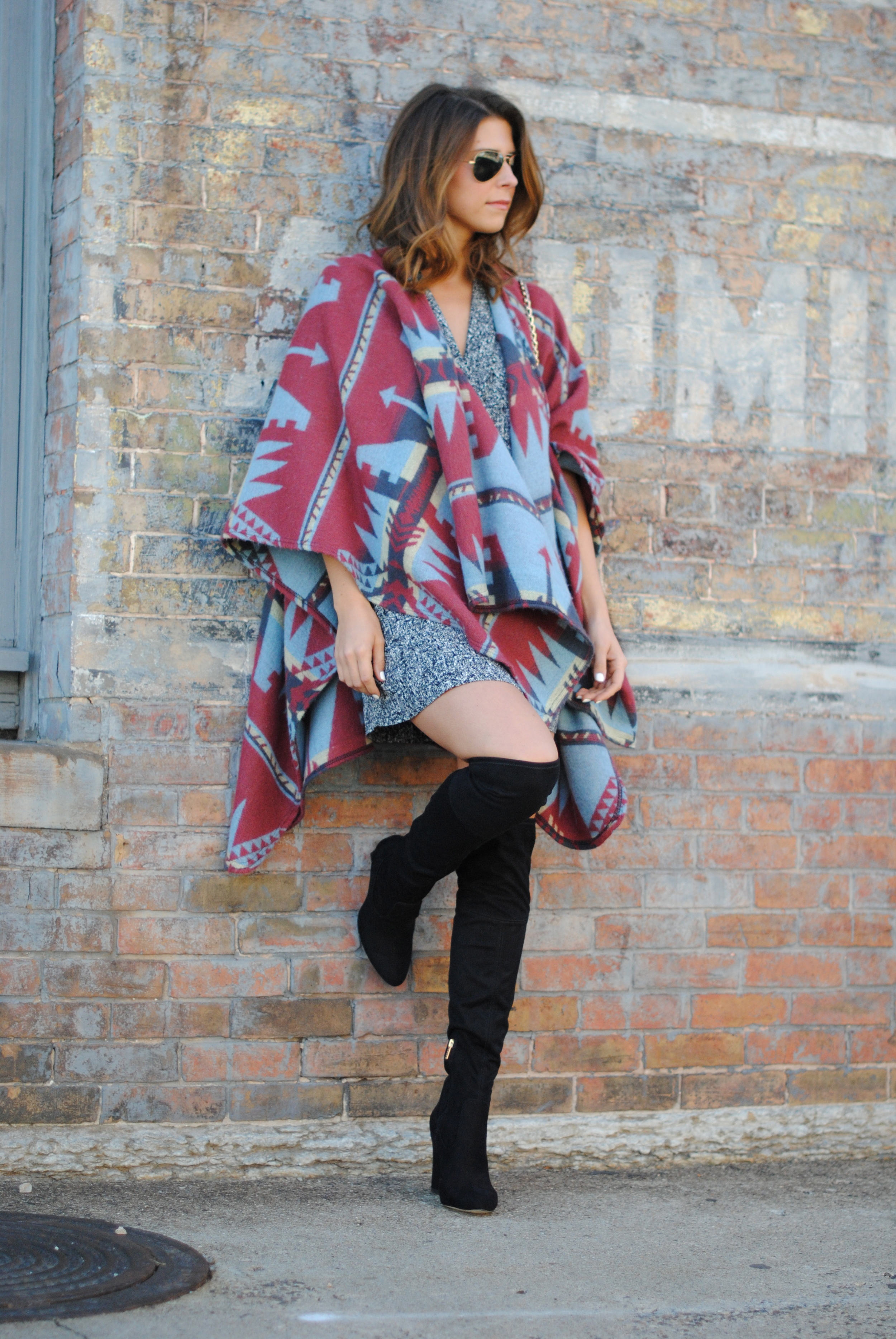 ASOS blanket cape (sold out), alternative  here and  here   Sandro dress, alternative  here  and  here    Over the knee boots   Vintage fur purse (sold out), shop the store  here    Ray-ban aviators