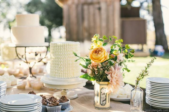 Wedding Centerpiece with garden roses antique tins and herbs
