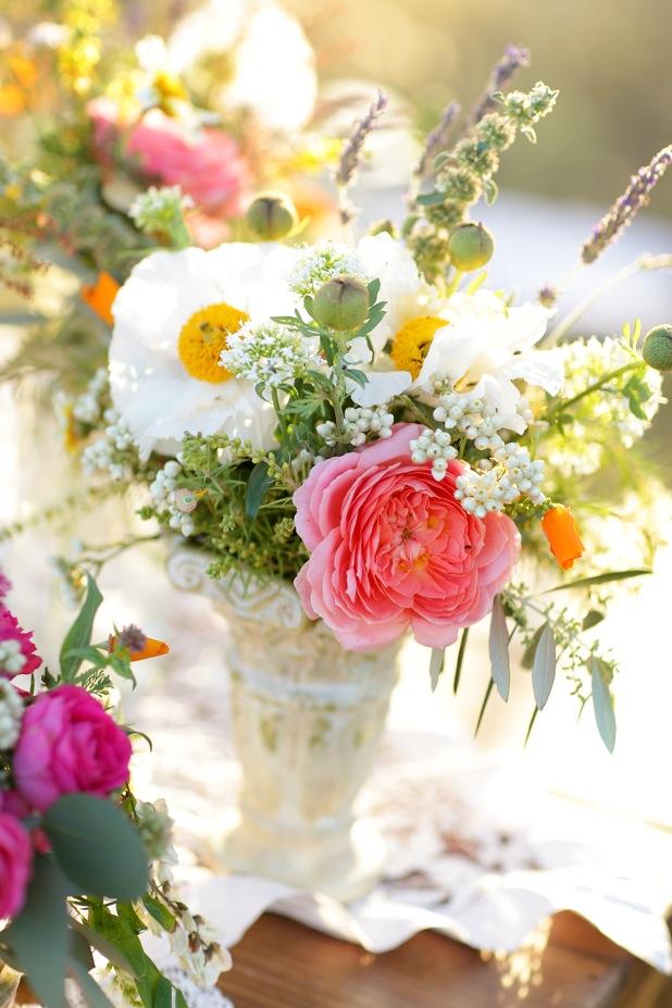 Arrangement full of Poppies and Garden Roses