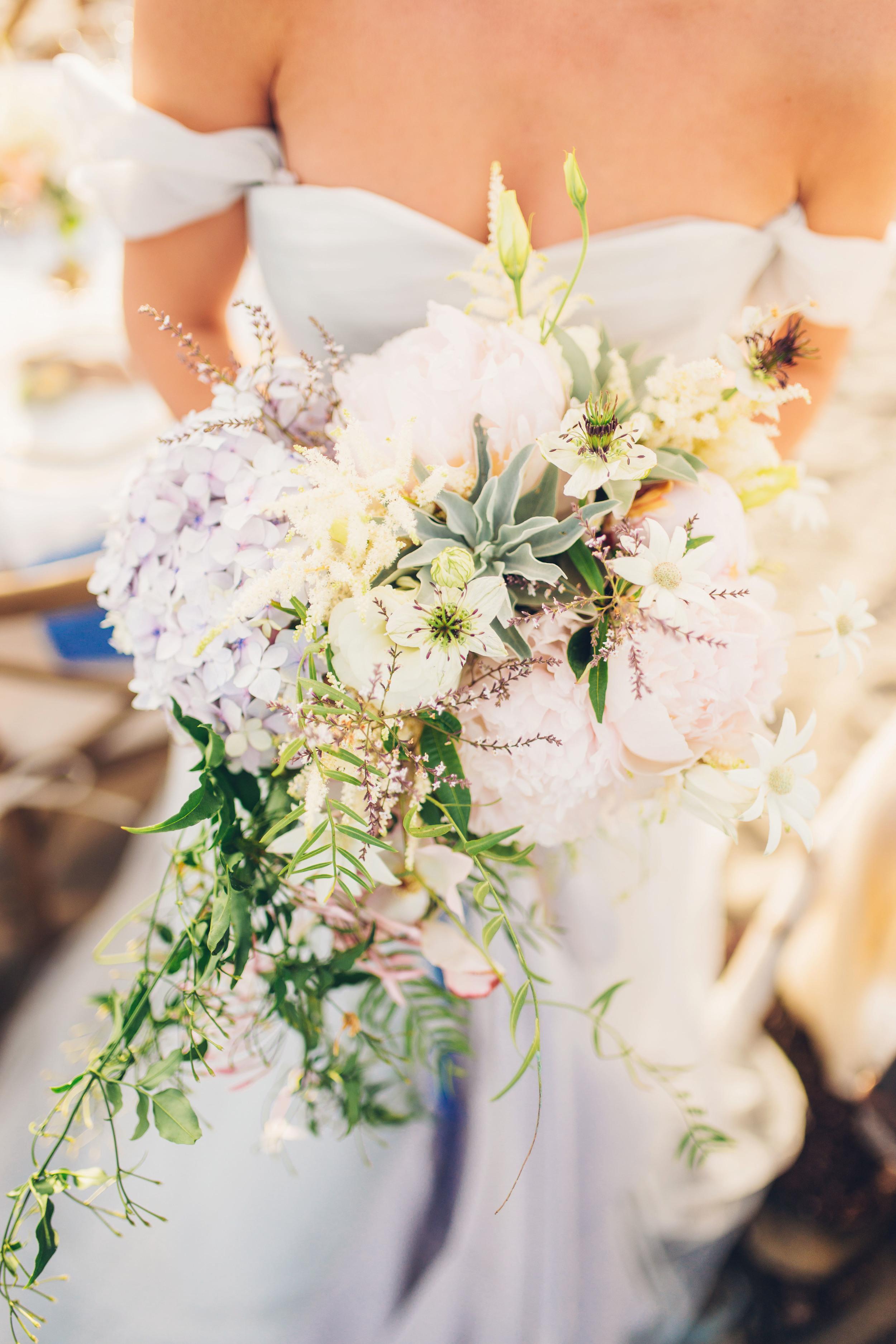 Overflowing bouquet of Peonies, Hydrangeas, and Jasmine