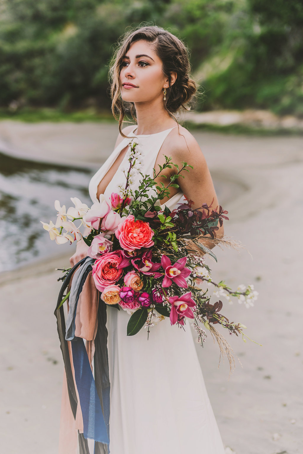 Sea inspired bridal bouquet wrapped with silk ribbon