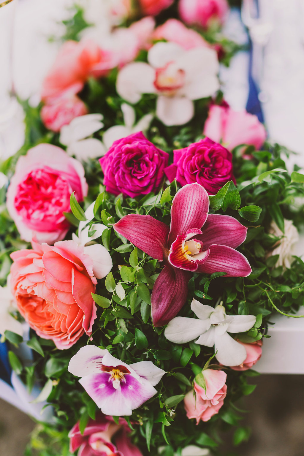 Tablescape of garden roses and orchids