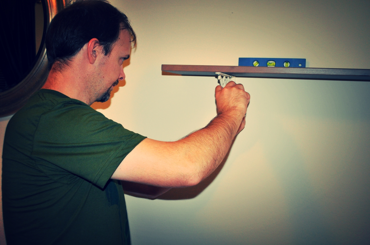Hubby J with his trusty level installing shelf #1.