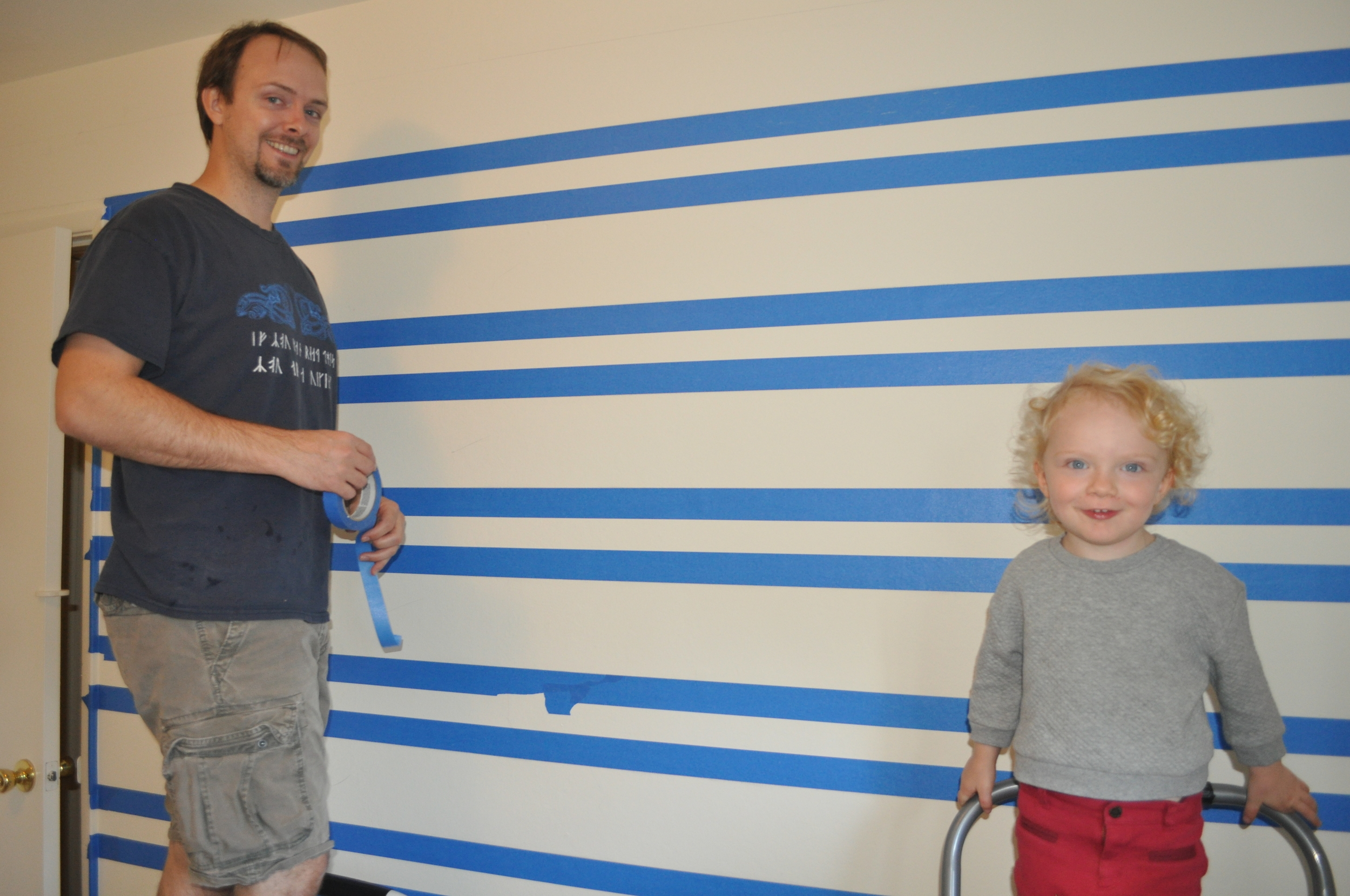 Toddler G getting in on the taping action!