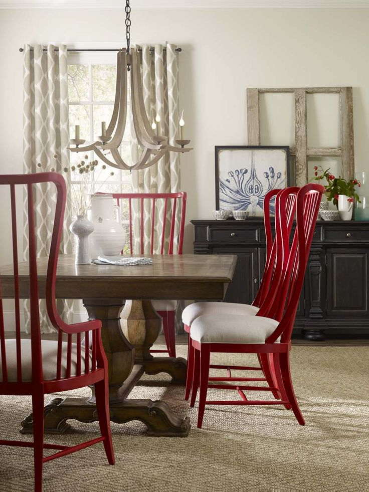 I love the  red chairs  around the  Hooker Furniture Sanctuary  Dining Table