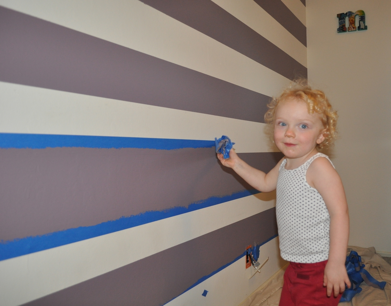 Removing the tape with help from Toddler G