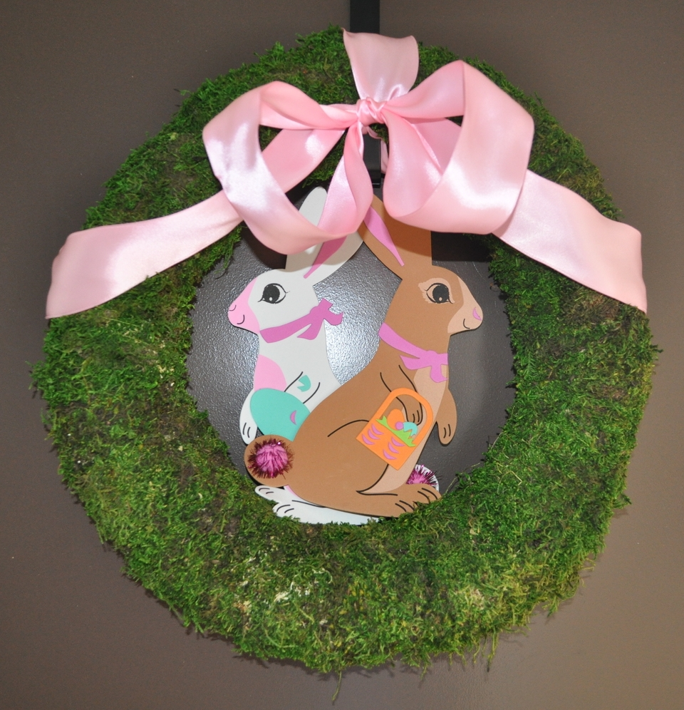 My everyday moss wreath dressed up with left-over pink ribbon and some of the Target rabbit crafts I did with Toddler G