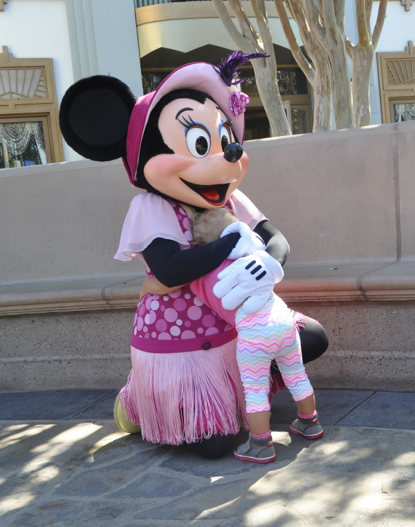 Baby M loving Minnie Mouse - the child had to hug every character she saw!