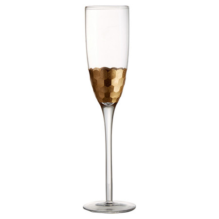 Gold accented champagne flute from  Joss & Main , love!
